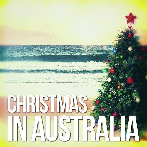 Girls with christmas hats are singing christmas carols, australia.